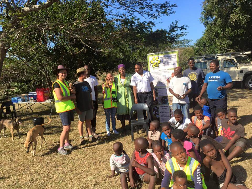 The team takes a break for a group pic with some of the local kids